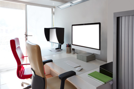 computer screens: Designer office desk with computer screens in white Stock Photo