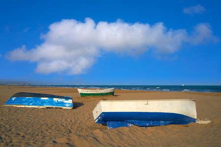 Valencia La Malvarrosa beach arenas beached boats in Spain Stock Photo