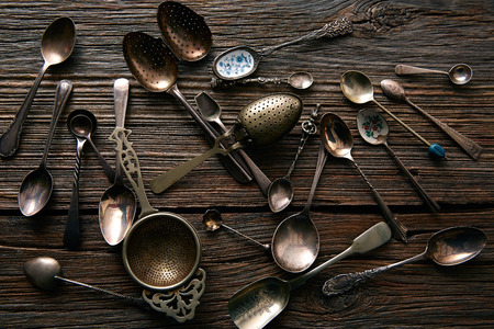 cooper: Vintage retro tea spoons and Strainers silver  on wooden background