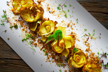 Artichoke roses with truffle and honey vinaigrette Stock Photo