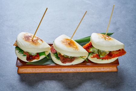 Gua bao meat and chicken asian food in a row