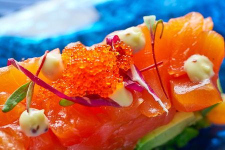desk: Salmon and avocado Tartare with soya and mustard mayonnaise Tartar Stock Photo