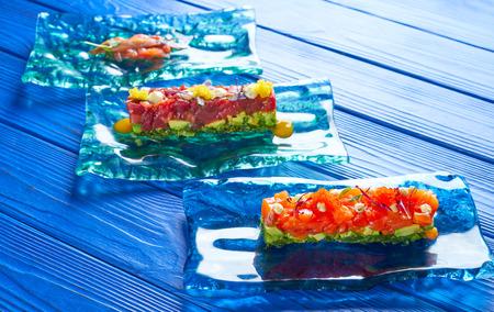 Salmon and Tuna Tartare with Anchovies tomato starter Tartar tapas
