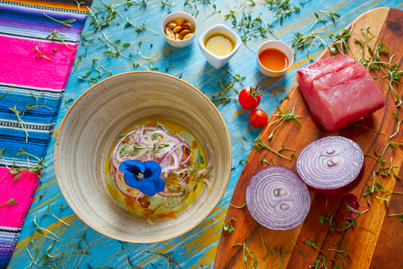 Fish ceviche latin preuvian recipe on bowl with pansy flower Standard-Bild