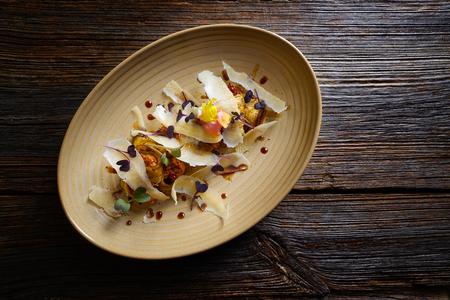 avantgarde: Aubergine and cheese recipe italian food on wood table Stock Photo