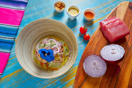 Fish ceviche latin preuvian recipe on bowl with pansy flower Stock Photo