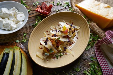 Aubergine and cheese recipe italian food on wood table Stock Photo