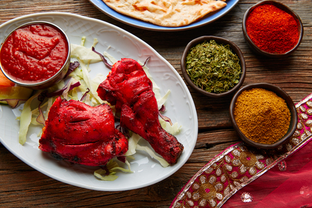 tandoori chicken: Chicken Tandoori indian recipe with spices on wood Stock Photo