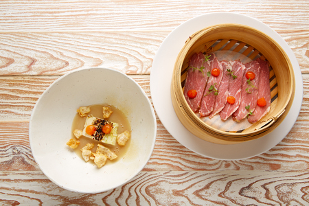 Iberian pork ham with XO sauce and cabbage stew with pork rinds