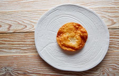 Fried tortilla on modern gastronomy white dish Stock Photo