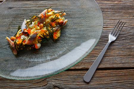 avantgarde: Smoked sardines salad with creamy cheese corn codium and hazelnuts Stock Photo