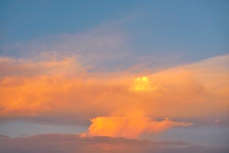 ablaze: Sunset sky orange clouds on blue colorful Caribbean cloudscape