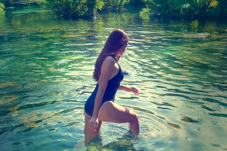 groundwater: Beautiful teen girl in cenote of Riviera Maya with swimsuit