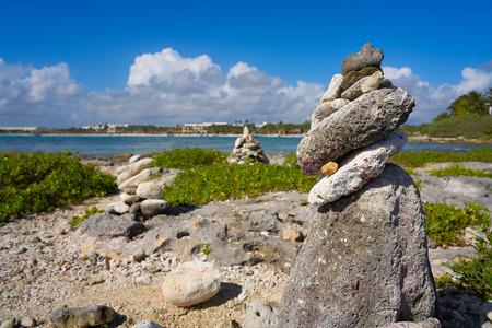 Akumal bay Cairn stone stacked in Riviera Maya of Mayan Mexico