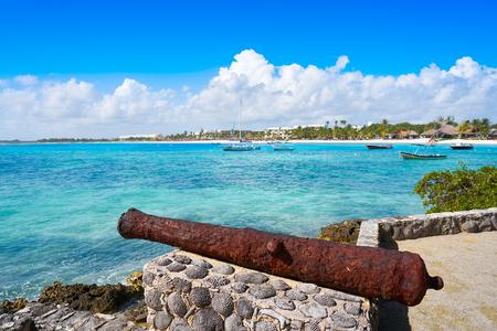 Akumal beach rusted iron canon in Riviera Maya of Mayan Mexico