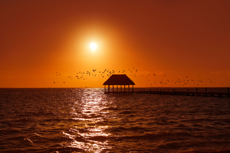 Holbox island sunset beach tropical hut pier in Mexico Stock Photo
