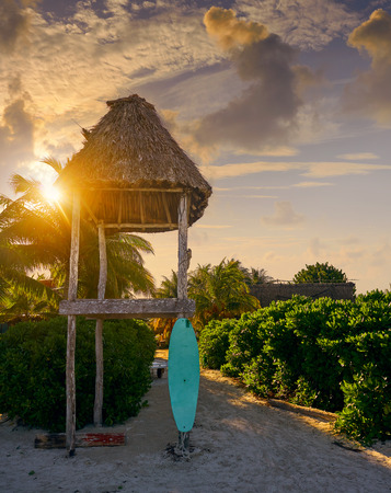 Holbox Island sunrise baywatch tower and surf board in Quintana Roo Mexico Stock Photo