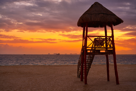 Isla Mujeres island Caribbean beach sunset baywatch tower Riviera Maya Mexico
