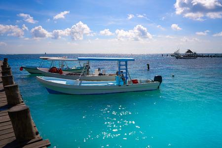 playa: Riviera Maya wood pier and boats in Mayan Mexico