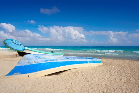Tulum Caribbean turquoise beach boat in Riviera Maya of Mayan Mexico