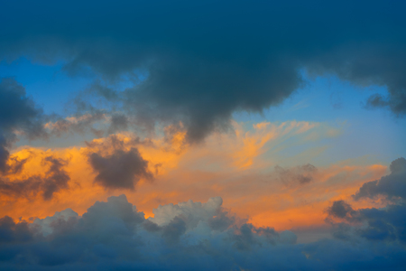 ablaze: Dramatic clouds at sunset sky orange clouds