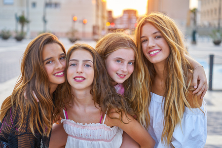 Best friends teen girls at sunset in the city group
