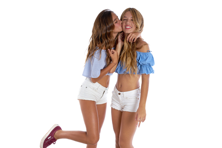 Teen best friends girls happy together kissing hug