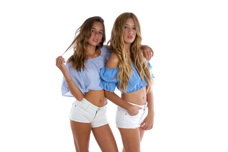 Teen best friends girls happy together on white background Archivio Fotografico