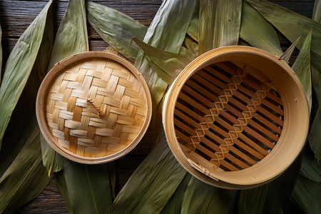 Asian kitchen bamboo steamer for steam cooking recipes on leafs