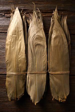 Dried Bamboo leaves in brown for Zongzi asian recipe preparation