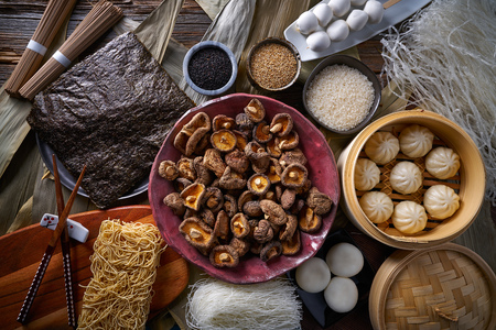 Shiitake rice dumplings steamed pork buns noodles Asian cuisine food mix