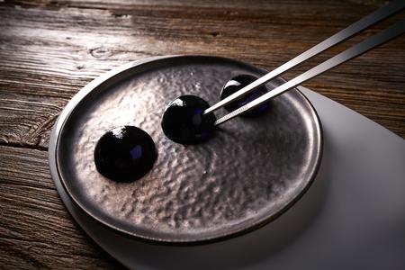 Molecular cuisine concept spheritions black jelly texture