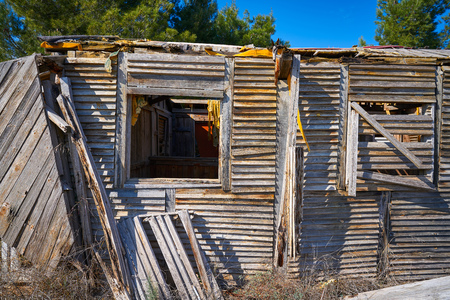 Old wooden cabin house destroyed by hurricane and abandoned
