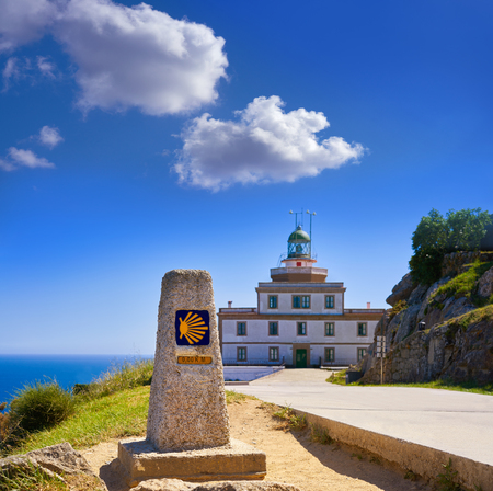 End of Saint James Way sign and lighthouse of Finisterre in Galicia Spain photomount Stock Photo - 109673378