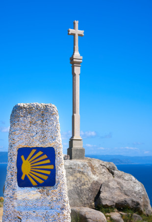 Cross in finisterre end of Saint James Way in Spain Camino de Santiago Stock Photo