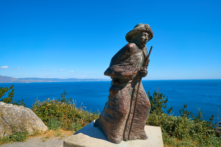 Pilgrim Statue at Cape Finisterre end of Saint James way in Galicia Spain