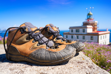 Used boots shoes at the end of Saint James Way in Finisterre Fisterra Camino de Santiago Spain