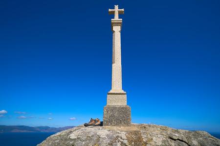 Cross in finisterre end of Saint James Way in Spain Camino de Santiago Stock Photo