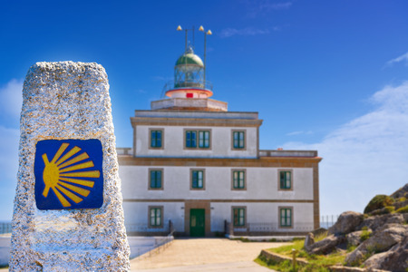 End of Saint James Way sign and lighthouse of Finisterre in Galicia Spain photomount Stock Photo