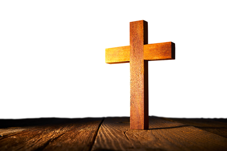 Christian wood cross on white and wooden background