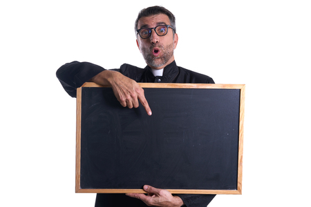 Priest holding empty blackboard copy space isolated on white Stock Photo
