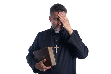 Priest male hands in head worried expression gesture