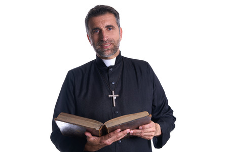 Priest portrait with Holy Bible in hands isolated