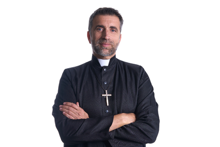 Crossed arms priest portrait senior male