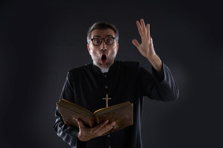 Mad crazy priest surprised expression scared