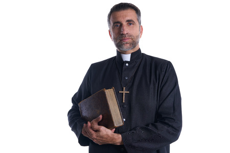 Priest portrait with Holy Bible in hands isolated on white