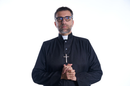 Priest pastor portrait praying hands relaxed