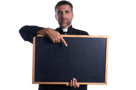 Priest holding empty blackboard copy space isolated on white