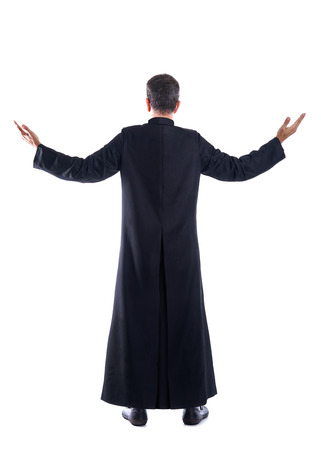 Full length priest blessing arm rear view of back soutane Stock Photo