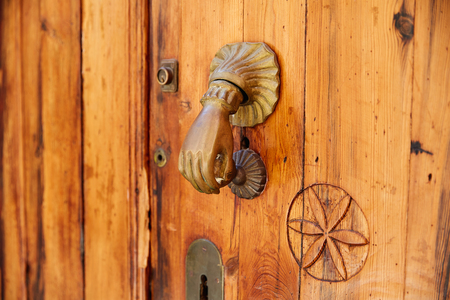 Door brass knock hand shape in Mediterranean Spain